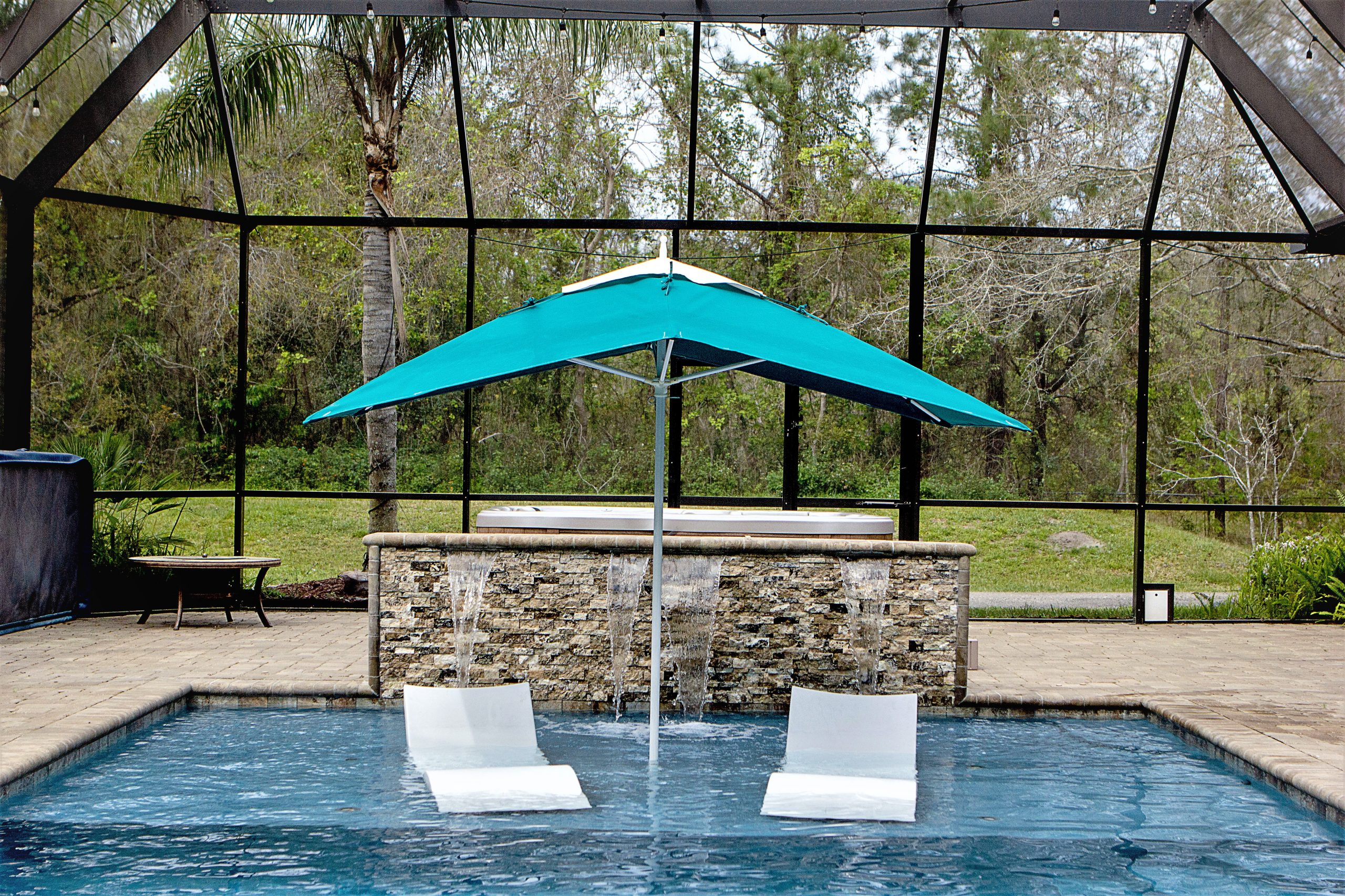 Light blue umbrella by pool