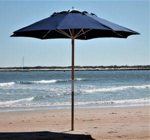 Dark blue umbrella on beach