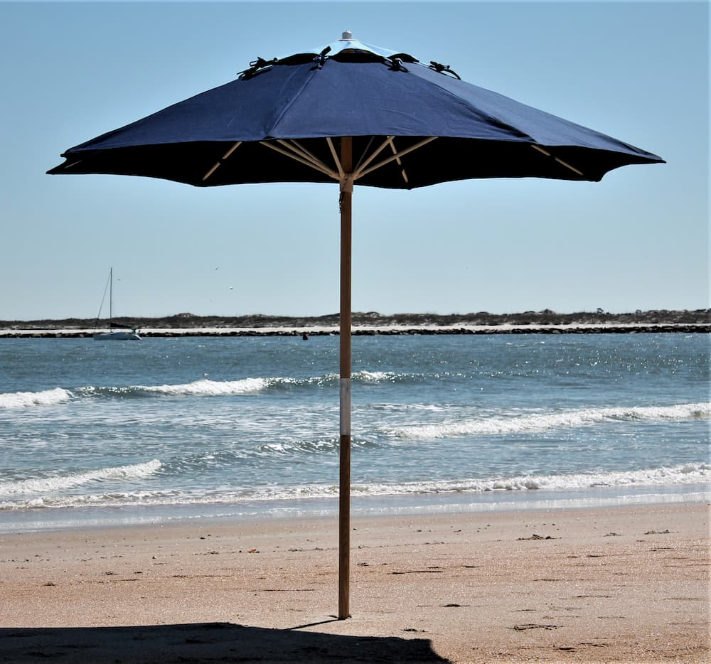 Dark blue umbrella on beach