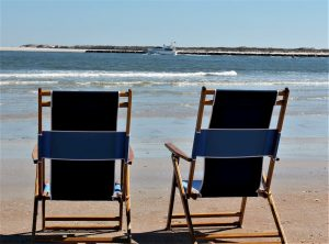 2 deck chairs facing the ocean