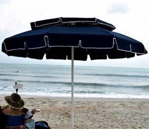 Dark blue umbrella by beach