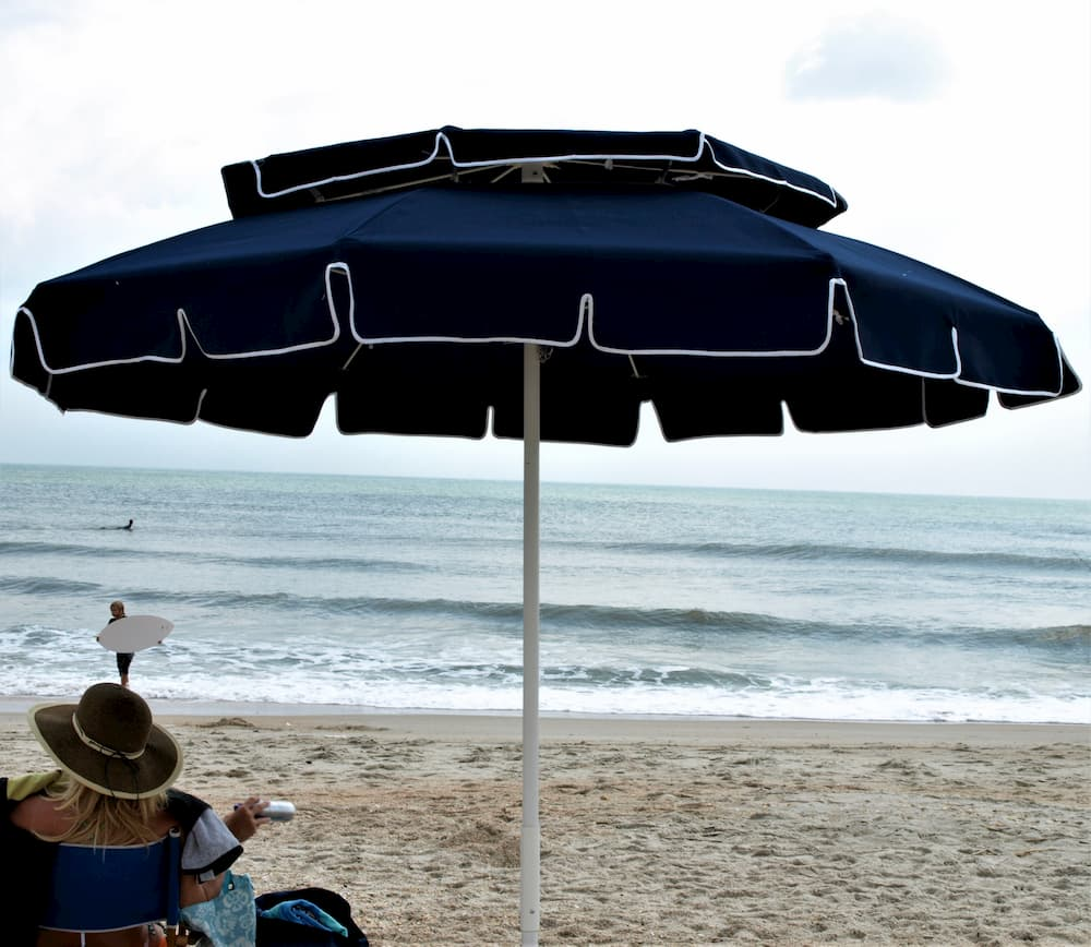 Dark blue umbrella by beach