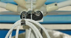 An umbrella drawstring pulled through the auto-lock pulley