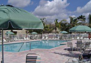 Green umbrellas by pool