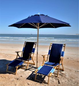 Blue umbrella and chairs on beach