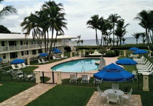Blue umbrellas by pool