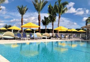 Yellow umbrellas by pool