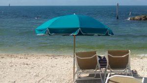 Light blue umbrella on beach