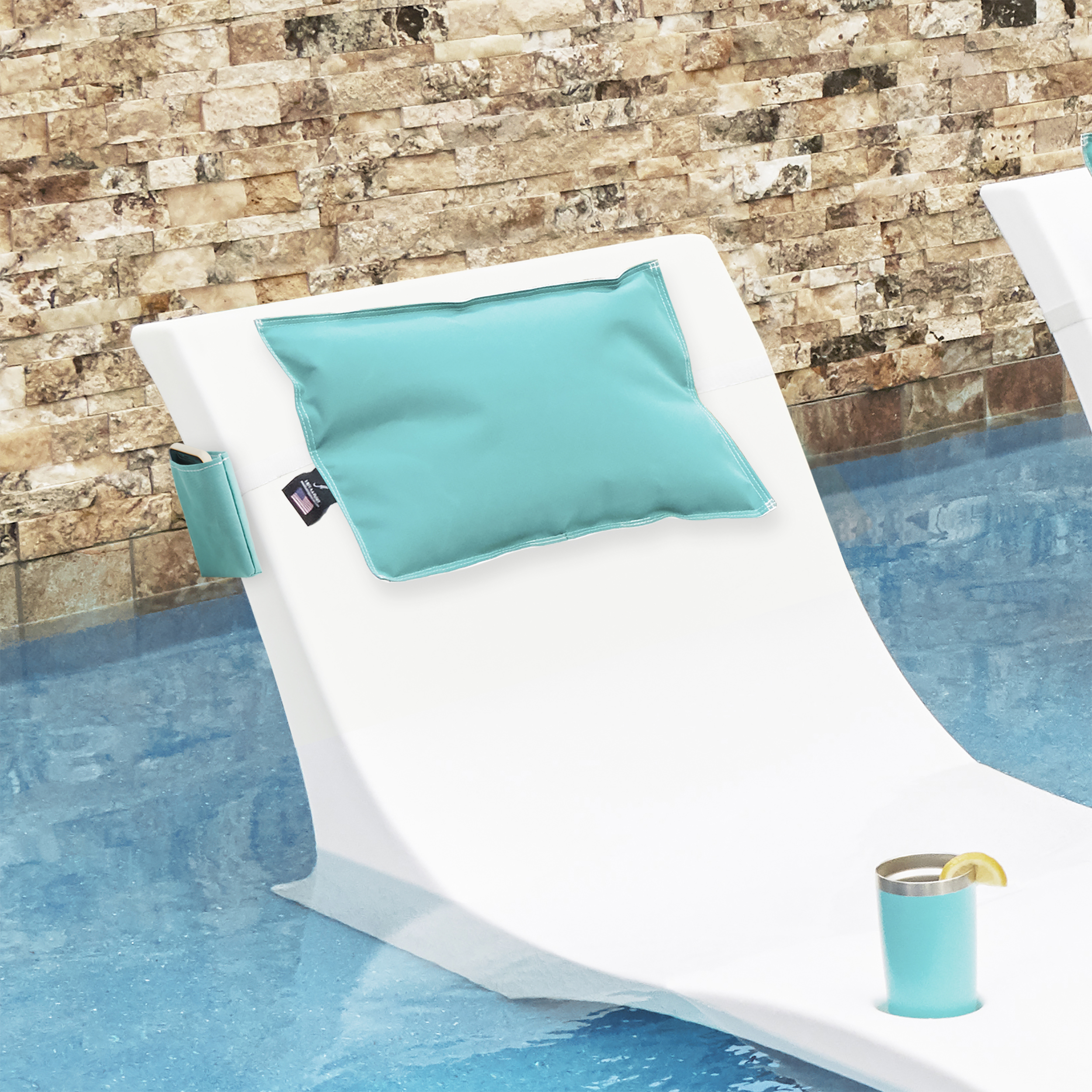 Aqua pillow on chaise