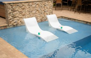 Chaise chairs in pool